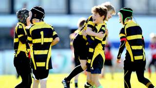 Minis rugby players celebrate