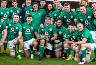 CJ Stander celebrates with the Millennium trophy and the team after making his last appearance for Ireland 20/3/2021
